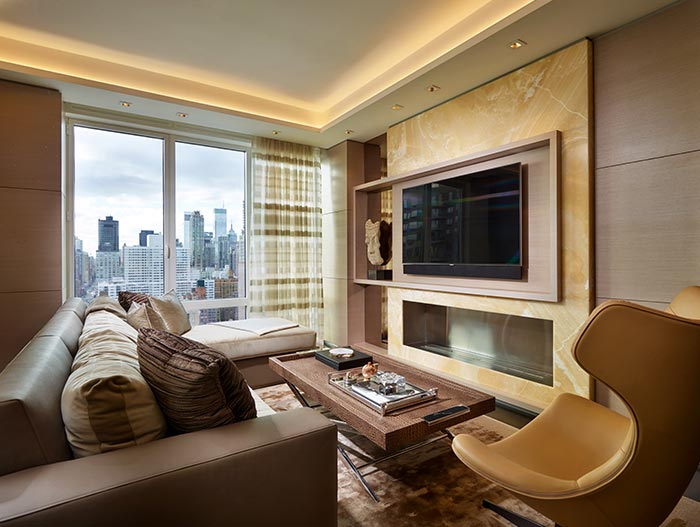 Beautiful Family Room With Comfortable Sofa And Chair And Beautiful Fireplace