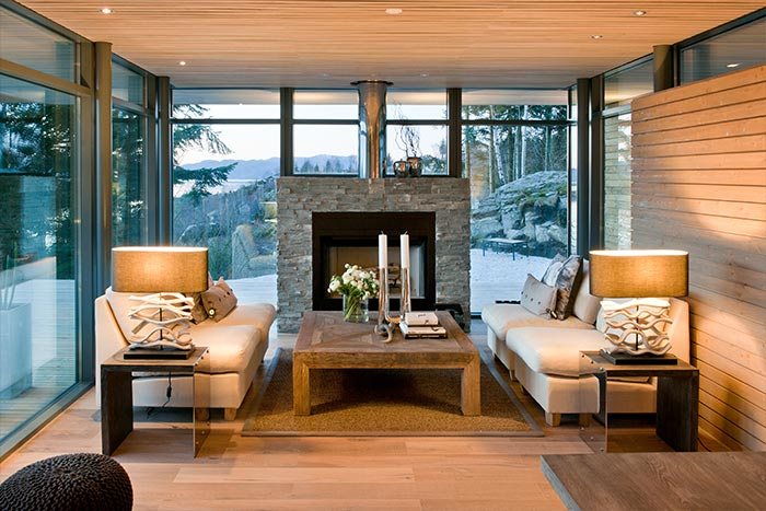 Beautiful Living Room With Modern White Sofas, Fireplace And Spectacular View