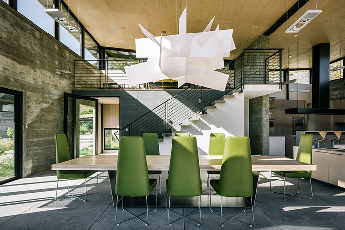 Contemporary Dining Room With Modern Green Chairs And Wooden Dining Table