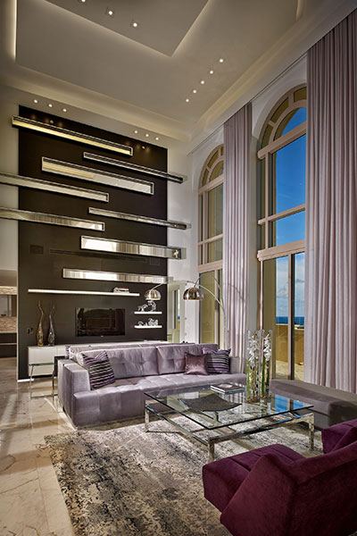 Contemporary Living Room With Large Mirrors On A Wall And Spectacular Ocean View