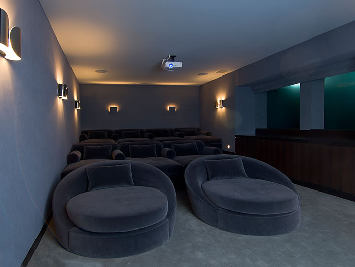 Hopen Place-Home theater by Whipple Russell Architects