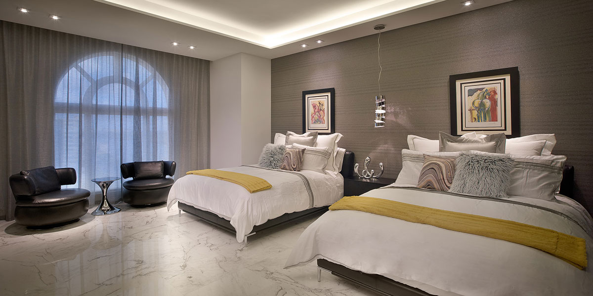 Modern And Inviting Guest Bedroom With Textured Satin Striped Gray Wall Covering