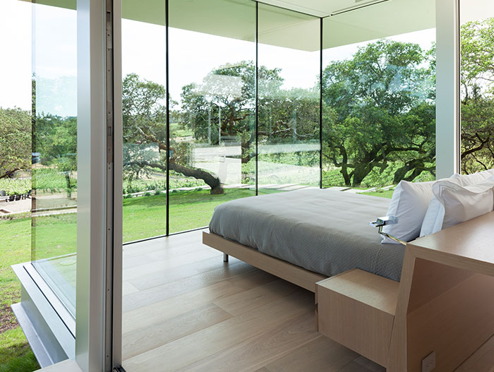 Modern Bedroom Design With Large Windows And Spectacular View