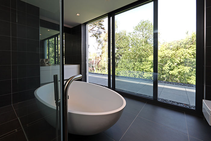 Modern Black Bathroom With Round Bathtub