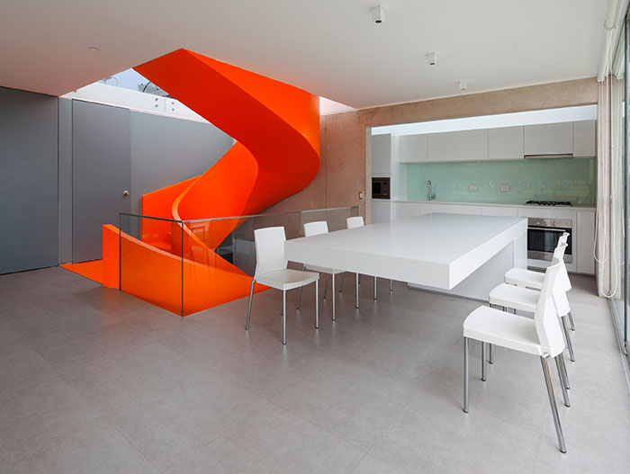 Modern Dining Room With Stunning Orange Staircase
