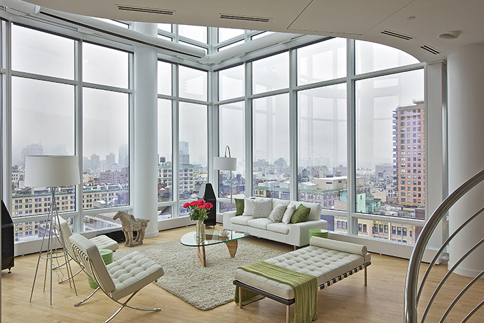 Modern Living Room With Beautiful White Sofa And Chairs And Stunning Views