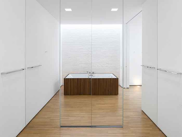 Modern white bathroom with rectangular bathtub