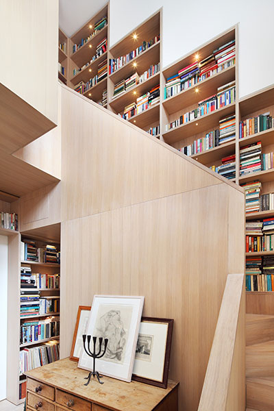 Walls Of Books Around Wooden Staircase