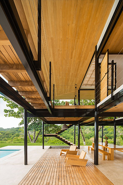 Stunning outdoor area of a beautiful eco-friendly house with movable wooden walls  in Costa Rica