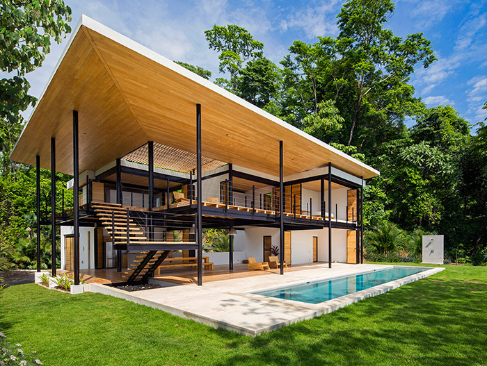 Beautiful exterior of an eco-friendly house with stunning pool and breathtaking views in Costa Rica