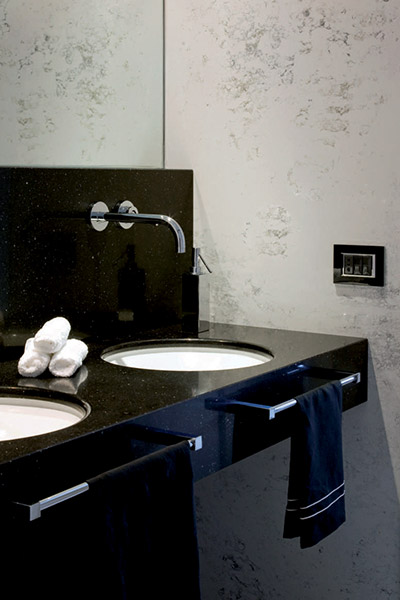 Black bathroom design in remodeled duplex apartment in Benevento, Italy by Ernesto Fusco