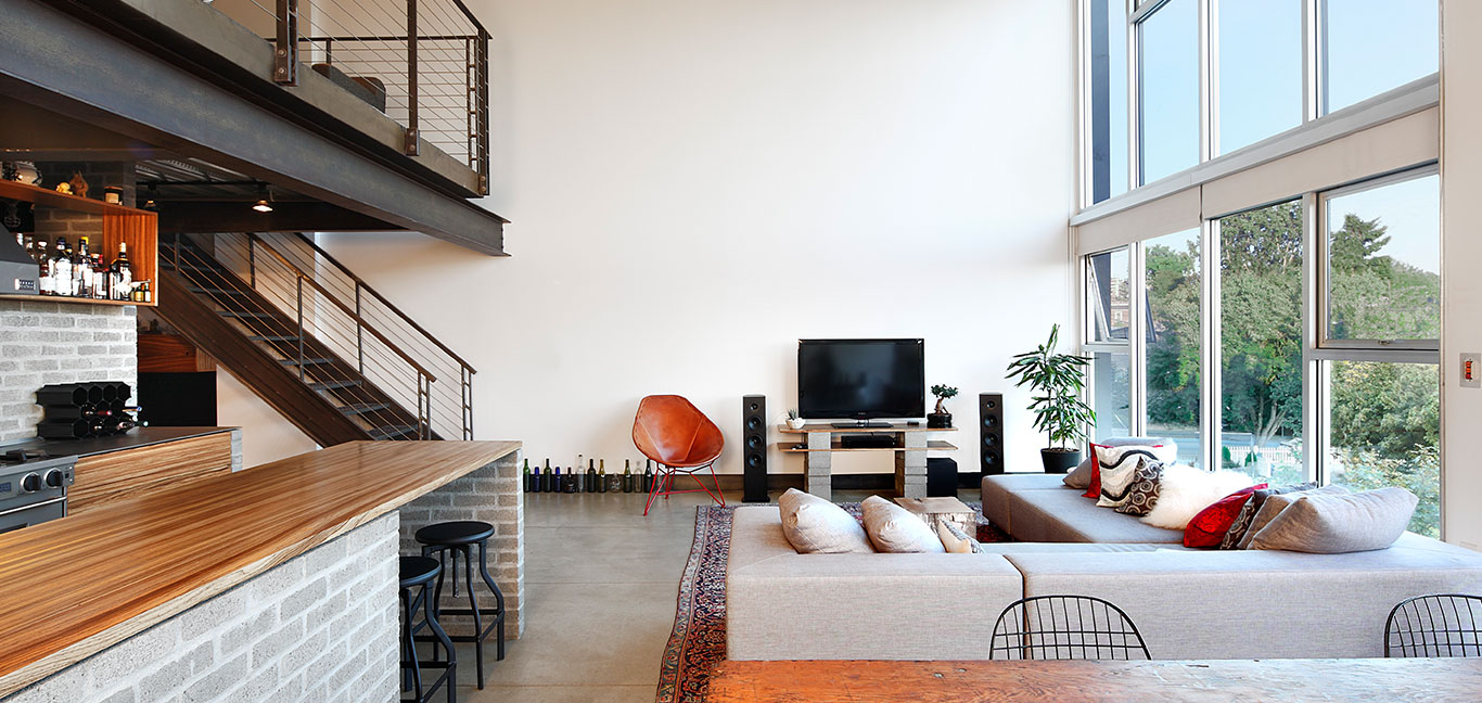 Modern industrial looking living room in Capitol Hill loft, Seattle by SHED Architecture