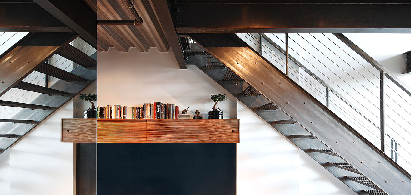 Stunning staircase in renovated Capitol Hill loft, Seattle by SHED Architecture