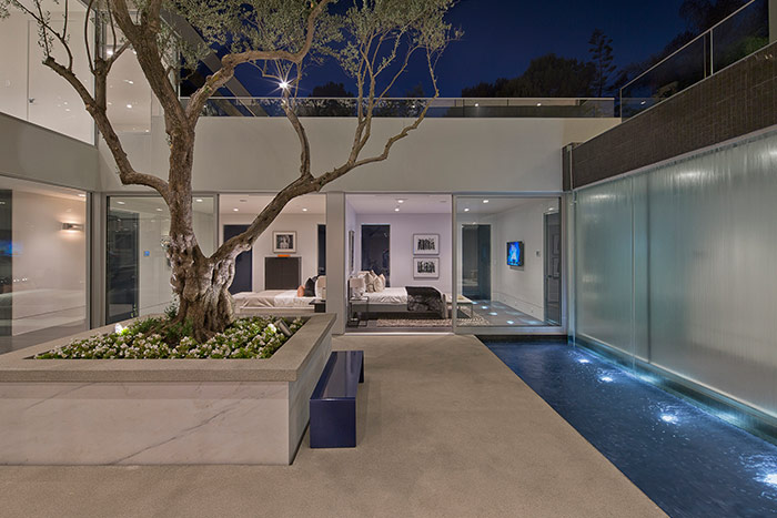 Carla Ridge residence: Beverly Hills mega mansion with gorgeous interior courtyard centered around old olive tree