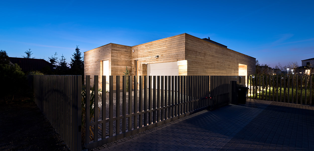 Cedar House in Poznan, Poland by Mariusz Wrzeszcz - cedar planks form the exterior walls that look amazing during the night