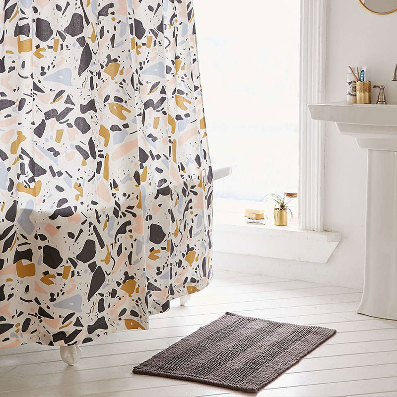 Playful and colorful shower curtain for a stylish bathroom - Killian Terrazzo shower curtain Urban Outfitters