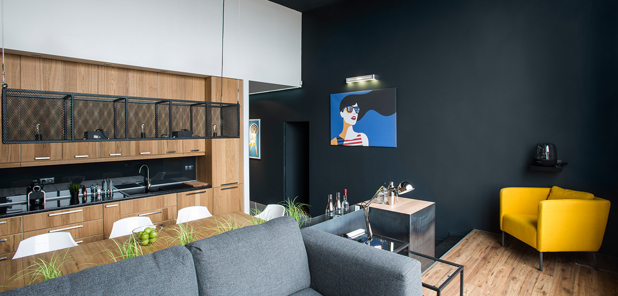 Colorful furniture and great art pieces in contemporary apartment in Hungary designed by GASPARBONTA