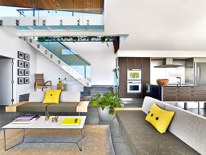 Colorful living room design idea in a contemporary beach house in Cape Cod by Hariri Hariri Architecture