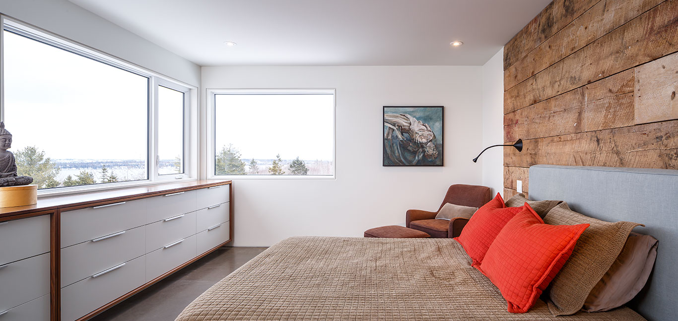 Cozy bedroom design idea in a contemporary three-storey house in Canada with stunning views by Omar Gandhi Architect