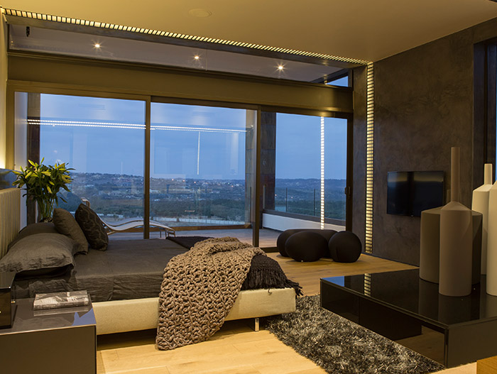 Luxurious bedroom design idea in a contemporary mansion with magnificent views - located in South Africa