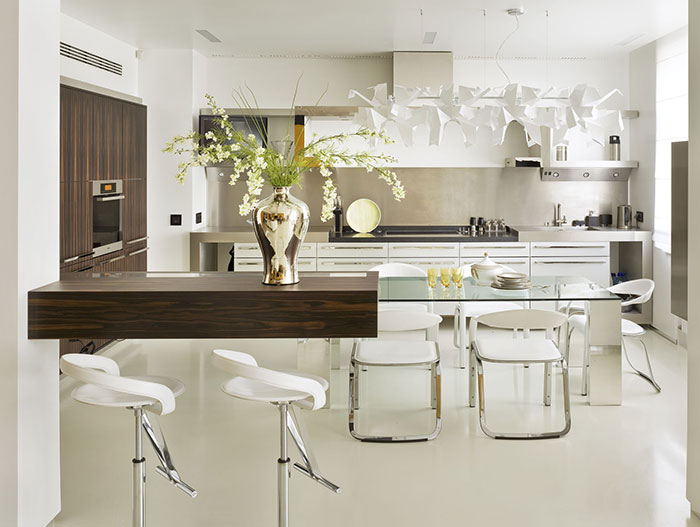 Contemporary white kitchen in Triumph Palace apartment in Moscow