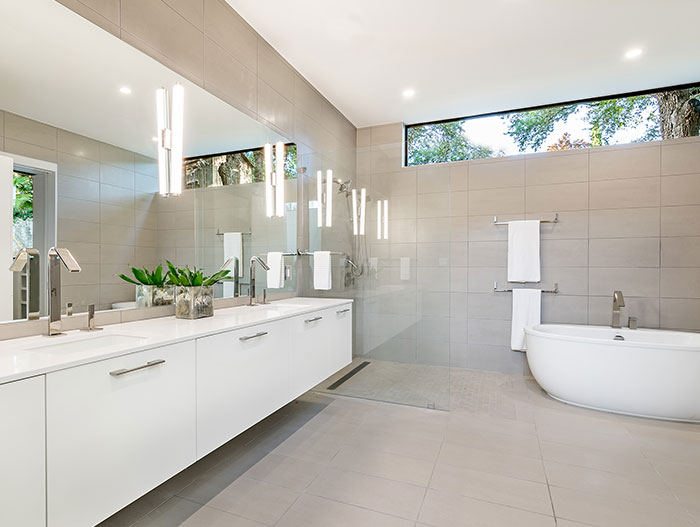 Dazzling house with modern bathroom, located in Austin, Texas - designed by Matt Fajkus Architecture for a young family