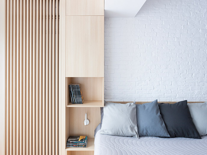 Modern bedroom design with modern furniture in a stylish, functional apartment in Bucharest by Rosu-Ciocodeica