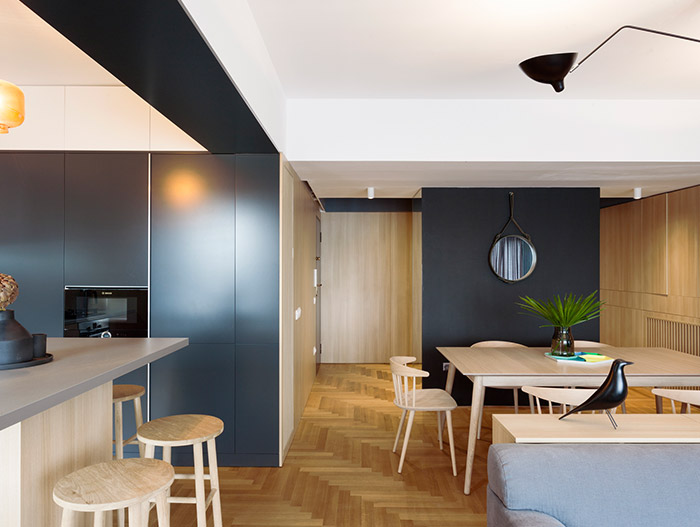 Functional apartment with wooden interior for a small family in Bucharest, Romania