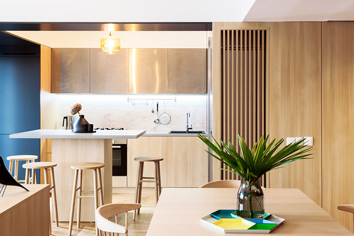 Modern kitchen design idea in a stylish, functional apartment in Bucharest by Rosu-Ciocodeica