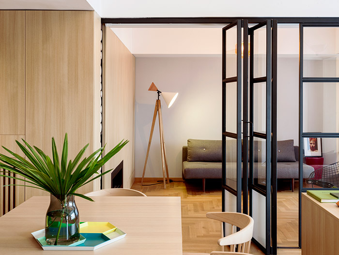 Functional apartment with stylish open space interior and sliding door that offers privacy for each family member - located in Bucharest, Romania