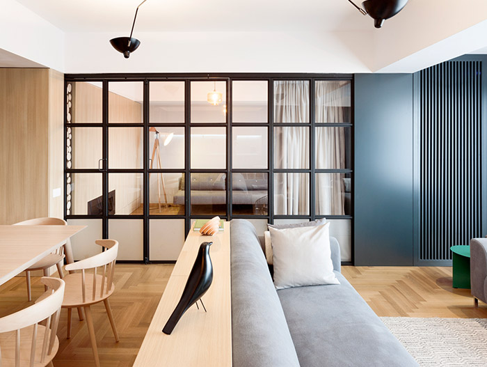 Sliding door in small functional apartment with stylish furniture in Bucharest, Romania