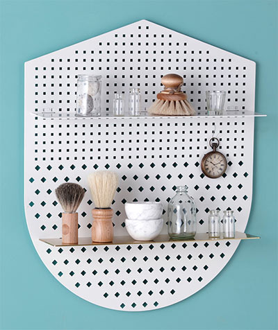 Functional perforated wall shelves - shield shape by Bride and Wolfe