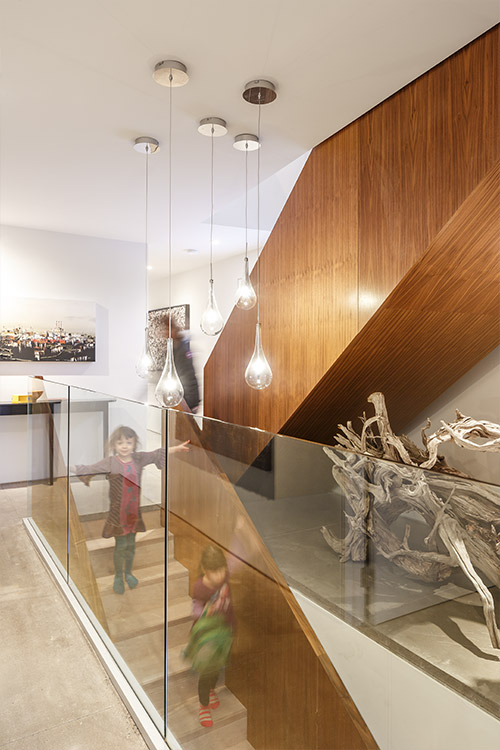 Walnut staircase in a contemporary house in Canada by Omar Gandhi Architect