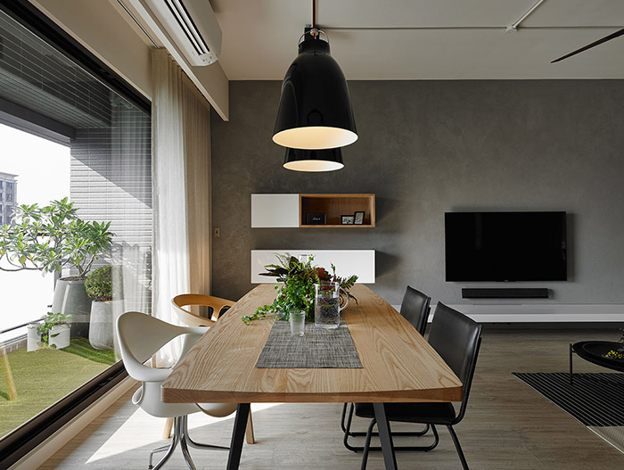 Gorgeous dining area design idea with modern dining table and beautiful white and black chairs in an inviting apartment in Taiwan - by Awork Design Studio