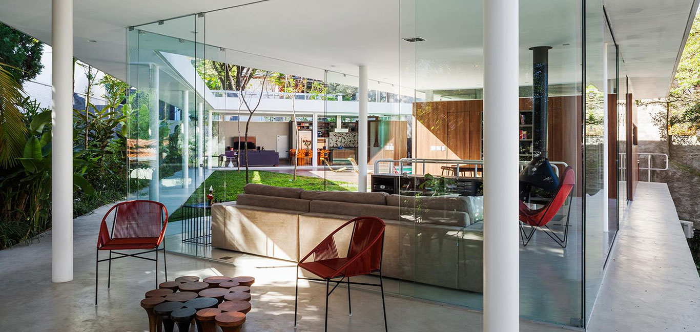 Incredible, spectacular living room full of glazing that allows for seamless transition to the outdoors and offers great views of the garden - Sao Paulo house by FGMF Architects