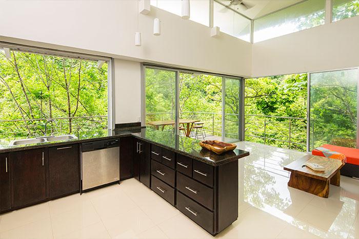 Modern kitchen design idea in amazing suspended house in Costa Rica