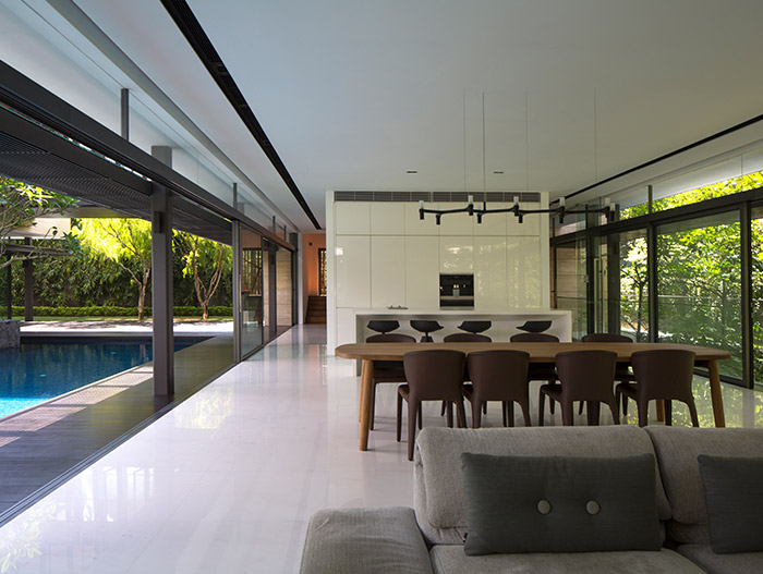 Secret Garden House: Open-space kitchen, dining and living room design idea in a luxurious, contemporary home in Singapore by Wallflower Architecture + Design