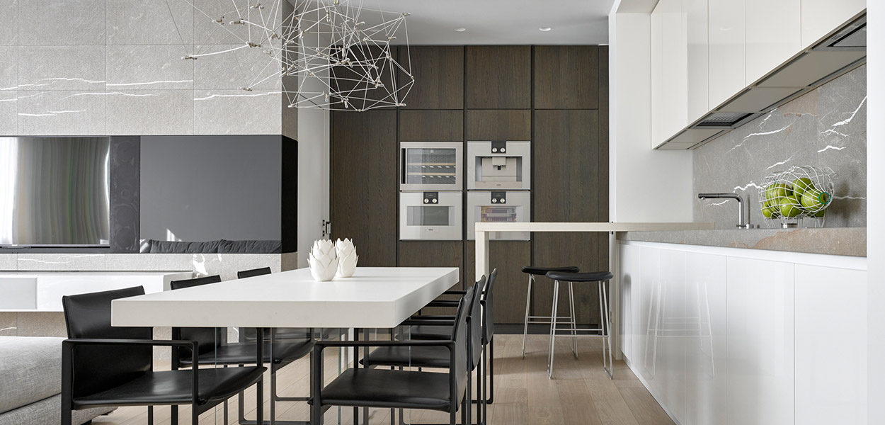 Modern open plan living, kitchen and dining area is the heart and soul of a modern comfortable Moscow apartment by Alexandra Fedorova