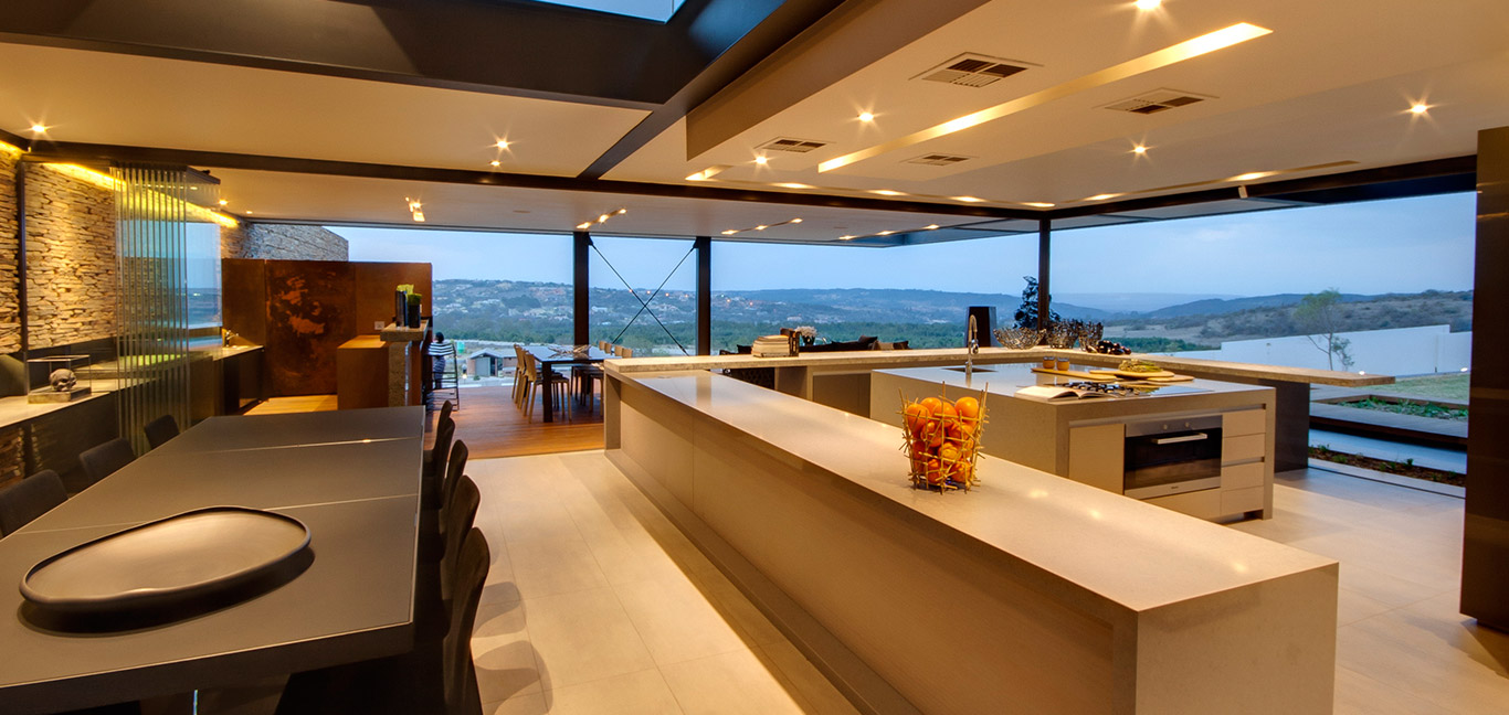 Luxurious open-space kitchen, dining and living area in a contemporary mansion with magnificent views - House Boz by Nico van der Meulen Architects