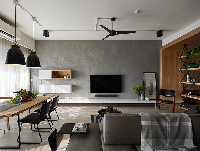 Open-space dining and living area of an inviting apartment in Taiwan