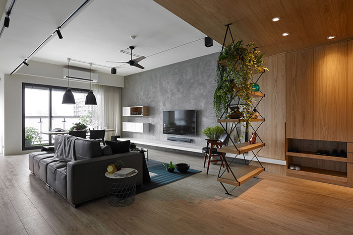 Explorer by Awork Design Studio: Stylish living room design idea in a modern, inviting apartment in Taiwan with plenty of spaces for the kids to play
