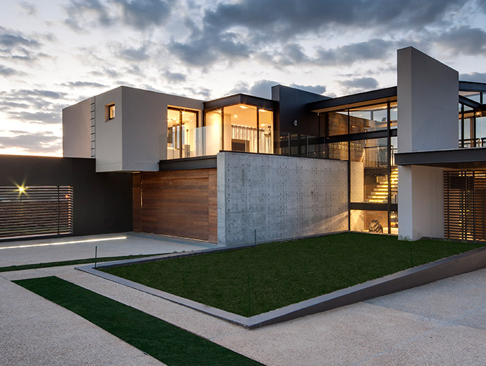 This luxurious contemporary mansion blends with the immediate surroundings - House Boz by Nico van der Meulen Architects