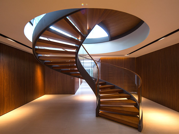 Secret Garden House: Amazing spiral staircase in a contemporary home in Singapore by Wallflower Architecture + Design