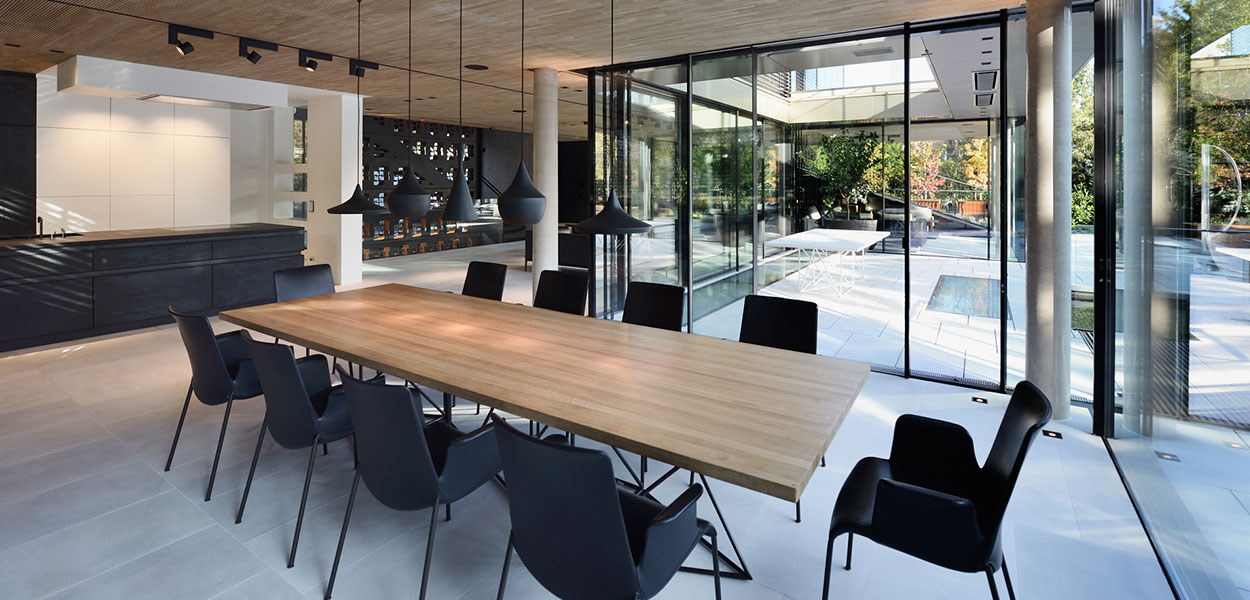 Stylish dining room design and stunning outdoor area of a luxurious villa in Vienna, Austria