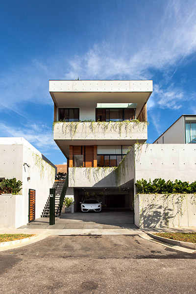 Entrance to luxury house in East Singapore by Aamer Architects - luxury car parked outside