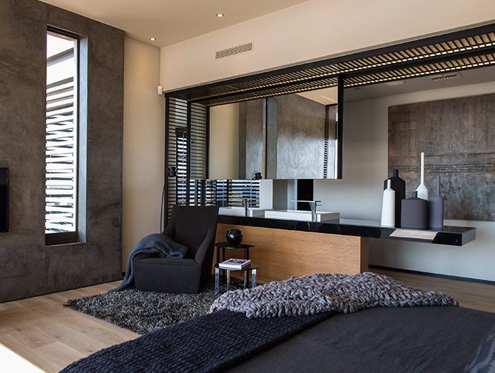 Luxurious and spacious bedroom design idea in a contemporary mansion with magnificent views - located in South Africa