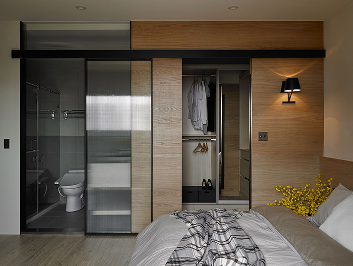 Modern master bedroom design idea with small bathroom and beautiful dressing in an inviting apartment in Taiwan - by Awork Design Studio