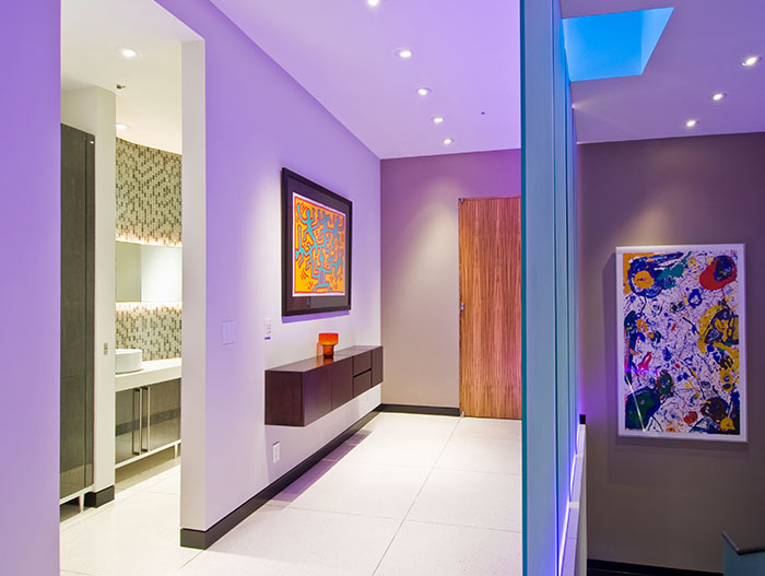 Modern bachelor pad with contemporary artwork in LED light staircase