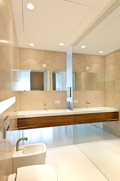 Modern bathroom with amazing LED lighting in minimalist white Moscow apartment