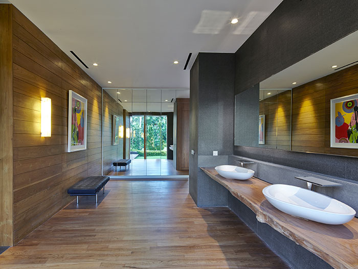 Modern bathroom in sophisticated modern Singapore home designed Robert Greg Shand Architects